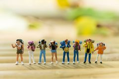 Miniature people : Backpacker Traveling as a team. Using as travel adventure concept Stock Image