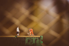 Miniature people boss and worker Royalty Free Stock Images