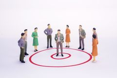 Miniature people business man in red circle graph. Miniature people business man in red circle graph over white background Royalty Free Stock Photos