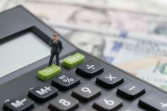 Miniature people business man thinking and standing with TAX min royalty free stock photos