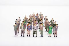 Miniature people business standing in crowd over white backdrop. Or background Stock Photography