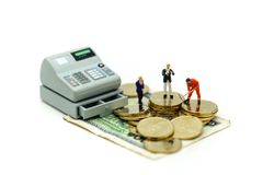 Miniature people : Businessman and construction worker with money,coins,contract of Business Construction concept. royalty free stock image