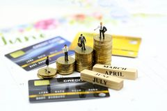 Miniature people : businessman with credit card and stack coins,commitment, agreement, investment, business and partnership. Concept stock images
