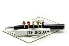 Miniature people : businessman and friend with Word Thank you on Thursday 27th,using for concept of Thank you Thursday.  stock image
