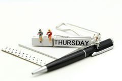 Miniature people : businessman and friend with Word Thank you on Thursday 27th,using for concept of Thank you Thursday.  stock images