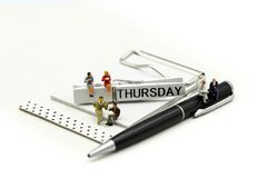 Miniature people : businessman and friend with Word Thank you on Thursday 27th,using for concept of Thank you Thursday.  royalty free stock photo
