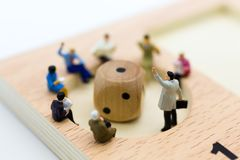 Miniature people : Businessman group consult business ideas, dice with risk. Image use for to solve problems, business concept.  Stock Photo
