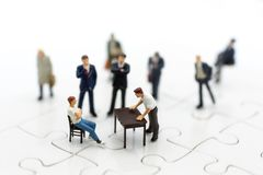 Miniature people : Businessman group consult business ideas. Image use for to solve problems, business concept.  Royalty Free Stock Image