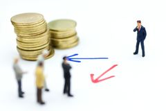 Miniature people: Businessman stand arrow pathway choice. Image use for business decision concept, teamwork Royalty Free Stock Image