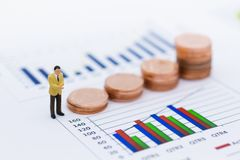Miniature people: Businessman stand front of dashboard, display graphs, profit margins of background. Image use for business. Concept stock images