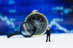 Miniature people: Businessman stand front of dashboard, display graphs, profit margins of  background. Image use for business Royalty Free Stock Photography