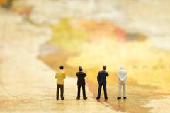 Miniature people : Businessman stand on map. Image use business concept Stock Photos