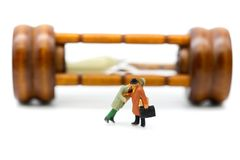 Miniature people : Businessman about to stab his friend,business. Concept Royalty Free Stock Image