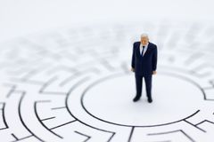 Miniature people : Businessmen in the maze. Image use for to solve problems, finding solution and think new idea concept.  royalty free stock photos