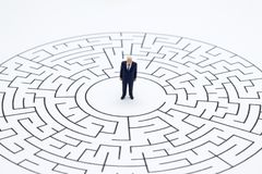 Miniature people : Businessmen in the maze. Image use for to solve problems, finding solution and think new idea concept.  royalty free stock image