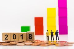 Miniature people, Businessmen are planning business next year, u. Sing as business increase benefit concept on 2018 Royalty Free Stock Images