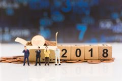 Miniature people, Businessmen are planning business next year, u. Sing as business increase benefit concept on 2018 Stock Photos