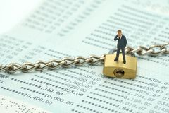 Miniature people businessmen standing Investment Analysis Or inv stock photo