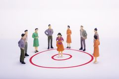 Miniature people businesswoman in red circle graph. Miniature people businesswoman in red circle graph over white background Royalty Free Stock Photos
