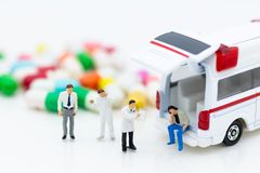 Miniature people: Check your health with doctor. Image use for drug, pills, capsules ,Health and medicine concept Royalty Free Stock Images