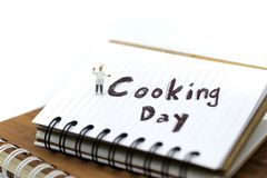 Miniature people : chef cooking using for concept of Cooking day stock photography