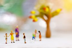 Miniature people, children and family enjoy with dog ,. Happy family day concept Stock Photos
