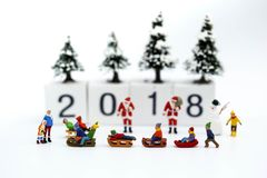 Miniature people : Children with Merry christmas and happy new y stock photos