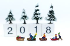 Miniature people: Children playing on snow funny together. Image use for Christmas festival. Miniature people: Children playing on snow funny together. Image royalty free stock images