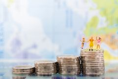 Miniature people: Children standing on top of stack coins . Image use for background , Life insurance concept.  Royalty Free Stock Photography