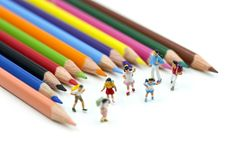 Miniature people : children and student with colorful drawing to stock photography