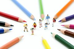 Miniature people : children and student with colorful drawing to royalty free stock images