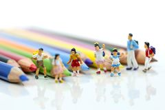 Miniature people : children and student with colorful drawing to royalty free stock image