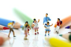 Miniature people : children and student with colorful drawing to stock photo