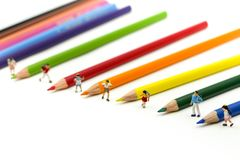 Miniature people : children and student with colorful drawing tools and stationary,education concept royalty free stock photos