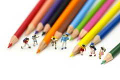 Miniature people : children and student with colorful drawing tools and stationary,education concept royalty free stock image