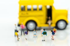 Miniature people : Children,students going to school with school bus. Image use for back to school, education concept.  Stock Photography