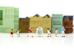 Miniature people : children,students with school,Back to school. Concept Stock Photography