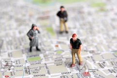 Miniature people and city map Royalty Free Stock Images