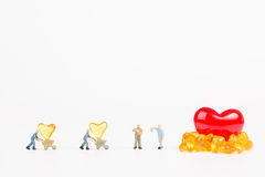 Miniature people with cod liver oil Stock Photos