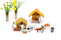 Miniature people: Construction workers building plans , have building materials, sand, brick, mortar. Use image for construction b. Usiness royalty free stock photography