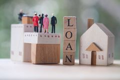 Miniature people contact and agreement banking to contact for approve home loans. Concept of the financial loans between the lender and the borrower. Secured stock photography