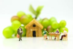 Miniature people: Couple family have diner background international family day concept. royalty free stock image