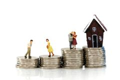 Miniature people : Couple of love with Stack of coins and mini h Royalty Free Stock Photo