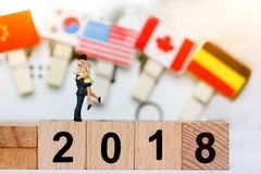 Miniature People Couple Lover Standing on wood block with number 2018, Royalty Free Stock Photos