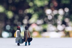 Miniature people - a couple of lover traveller walking to explore new adventure with beautiful nature bokeh background stock images