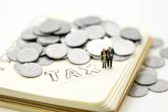 Miniature people : Couple oldman,family standing with notebook a stock photography
