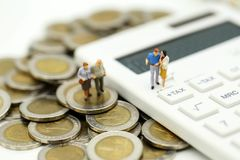 Miniature people : Couple oldman standing with Calculator,business,tax concept. royalty free stock image