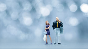 Miniature people - a couple walking Royalty Free Stock Photo