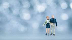 Miniature people - a couple walking Stock Photos