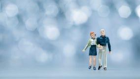 Miniature people - a couple walking Stock Photos